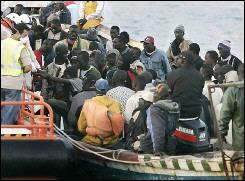 Would-be African immigrants arrive on a boat on May 18 at the port of Los Cristianos, Tenerife, Canary Islands.